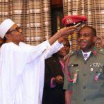 3fd3e96d-president-buhari-decorates-his-adc-2a-650×496-1631923564.jpg